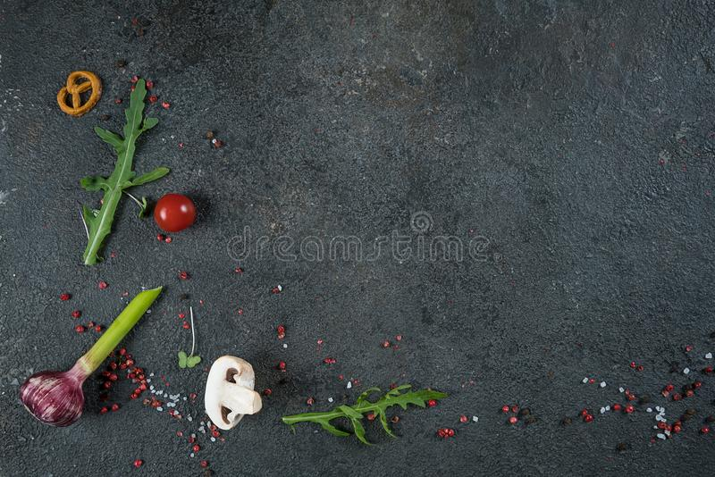 Selection of spices herbs and greens. Ingredients for cooking. Food background on black slate table. Top view copy space stock photo