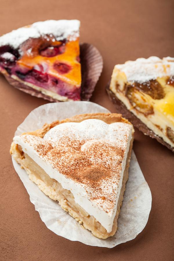 Selection of sweet slices on a brown background, selective focus royalty free stock photos