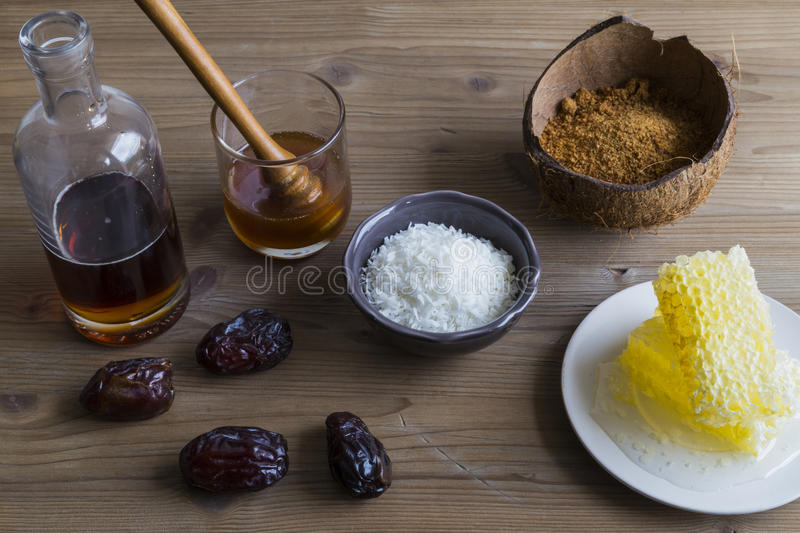 Selection of sweetener ingredients, including honey, sugar and maple syrup royalty free stock image