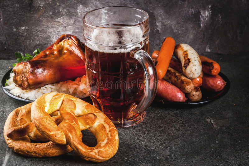 Selection food for Oktoberfest. Selection of traditional German food Oktoberfest. Beer, baked pork shank, popcorn, assortment of different sausages, homemade royalty free stock photo
