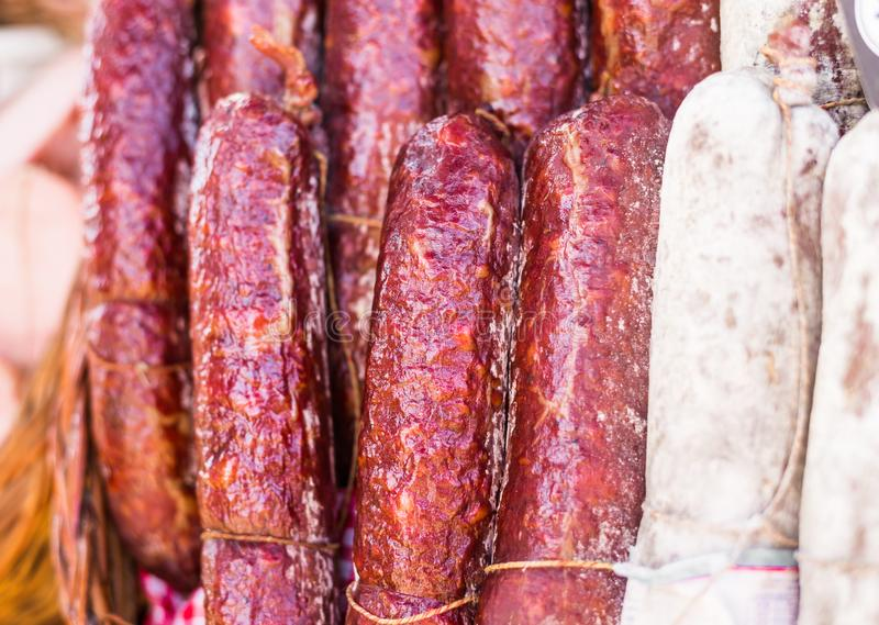 Selection of traditional Italian cured meats and sausages at street food market. Traditional Italian cured meats and sausages at street food market stock image