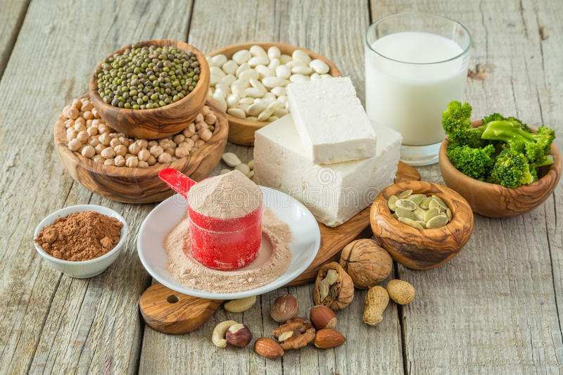 Selection vegan protein sources on wood background stock image