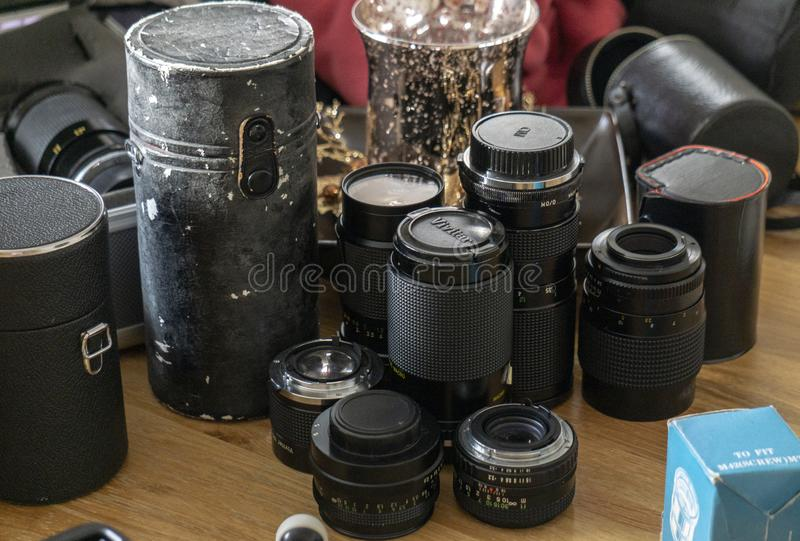 Vintage Camera Lenses on a table royalty free stock image