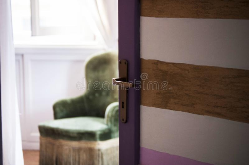 Selective closeup shot of a brown and purple open door royalty free stock photography