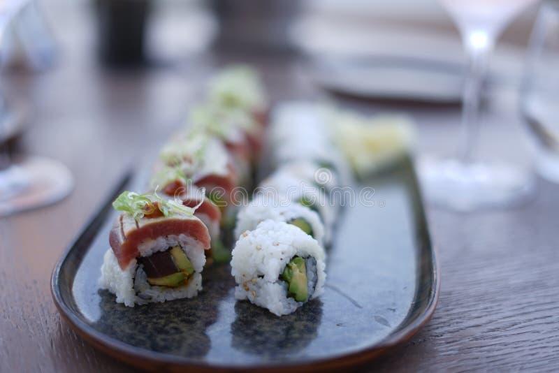 Selective closeup shot of sushi rolls on a silver platter. A selective closeup shot of sushi rolls on a silver platter royalty free stock photos