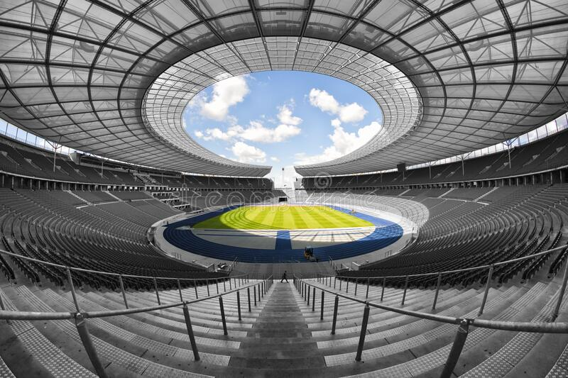 Selective Color Photography of Person at Soccer Stadium during Daytime stock image