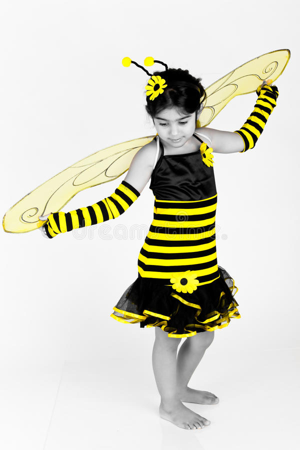 Selective coloring bee. Cute Little girl wearing a bee costume on white background stock image