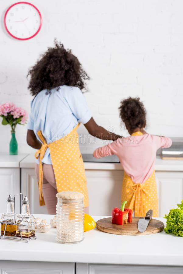 Selective focus of african american family cooking. On kitchen royalty free stock photo