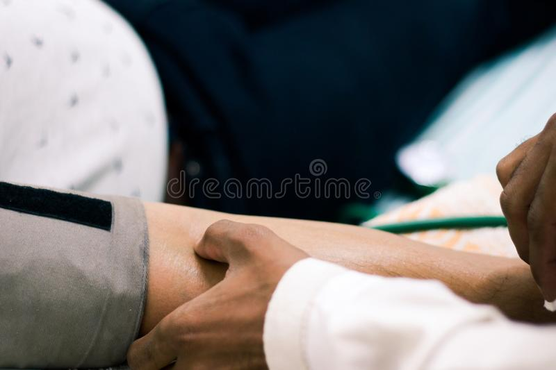 Selective focus of arm of patient for drawing of blood royalty free stock image