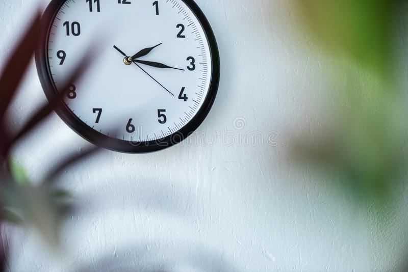 selective focus of black and white clock hanging stock image