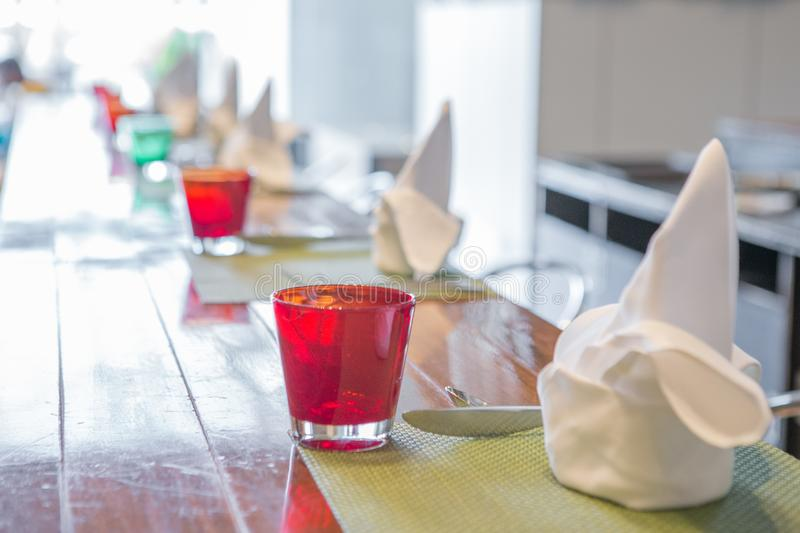 Selective focus of Bright colored glass on the  dining table. Selective focus of Bright colored glass on the dining table royalty free stock photography