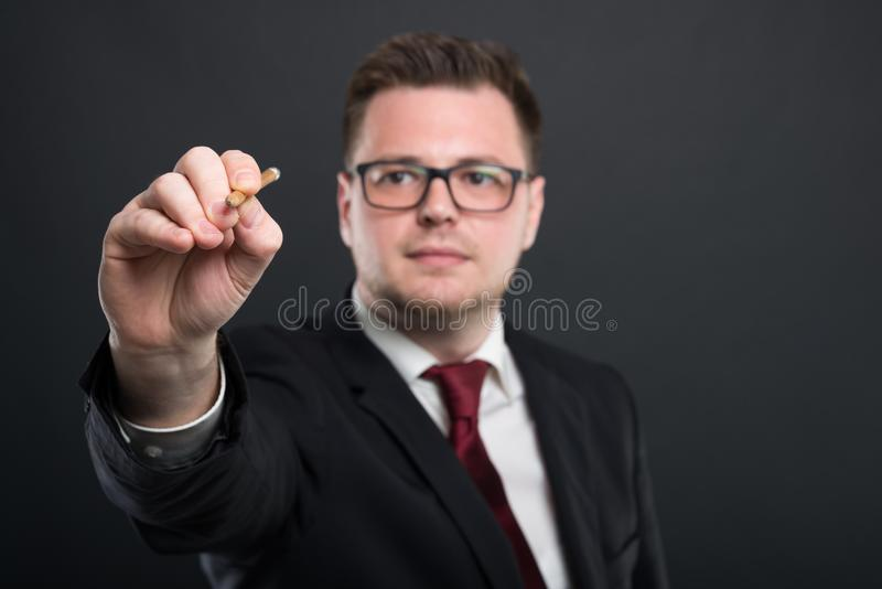 Selective focus of business young man writing with graphic penci stock photo