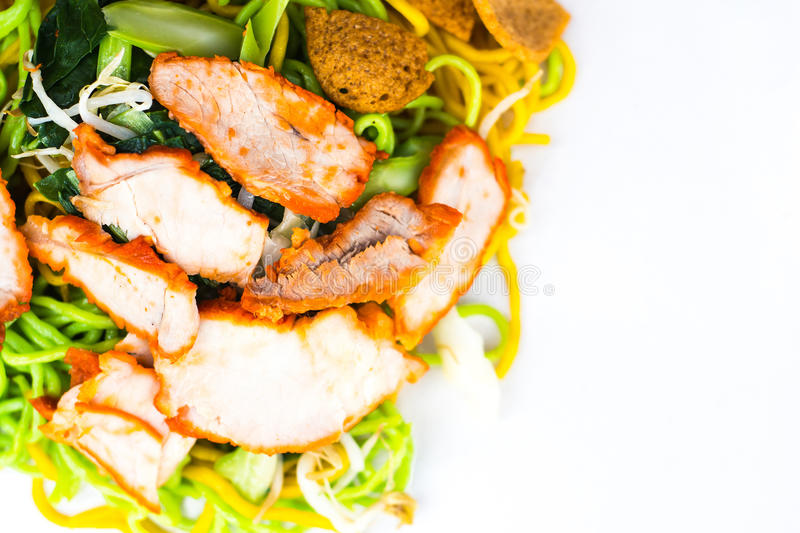 Selective focus in center, Egg noodles served dry with red roast pork stock images