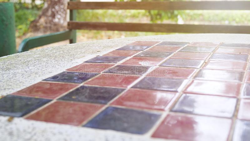 Selective focus of chessboard with sunlight on blurred bacground stock photos