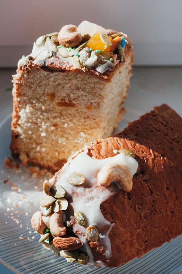 Homemade Easter cake decorated with icing, nuts, candied fruit royalty free stock image