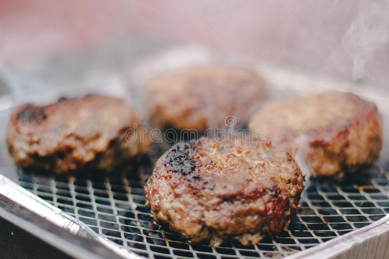 Selective focus closeup shot of delicious fresh meat barbecuing to perfection stock images
