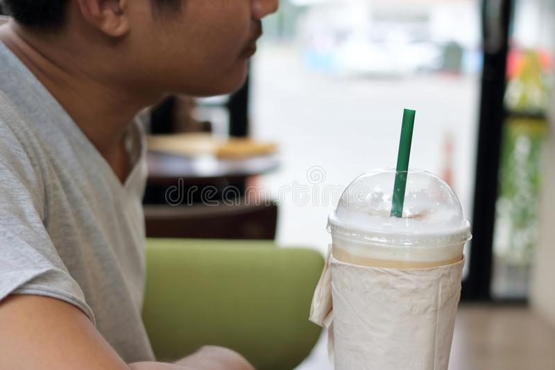 Selective focus on coffee cup in coffee shop royalty free stock photography