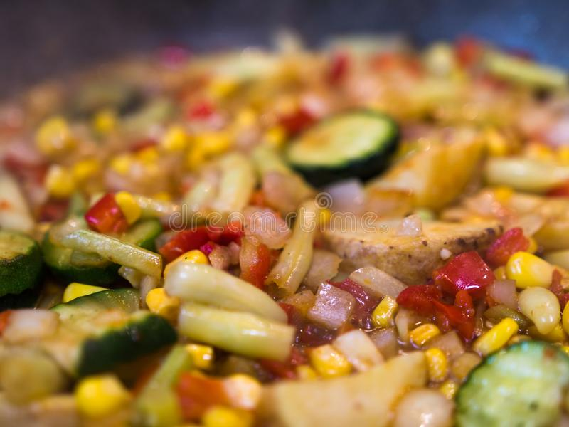 Selective focus of colorful vegetables mix being prepared on frying pan royalty free stock photos