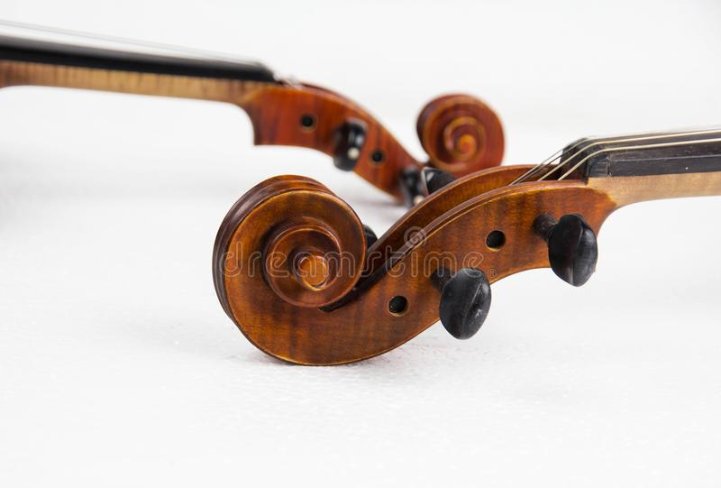 In selective focus of the construction of violin,Scroll,Pegbox and neck,on white background. Blurry light background royalty free stock photography