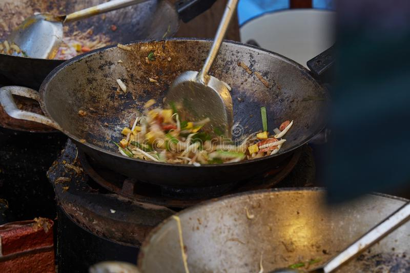 Selective focus of cooking Pad Thai Goong Sod in pan, Fried noodle Thai style with prawns. Selective focus of cooking Pad Thai Goong Sod in pan, Fried noodle royalty free stock photography