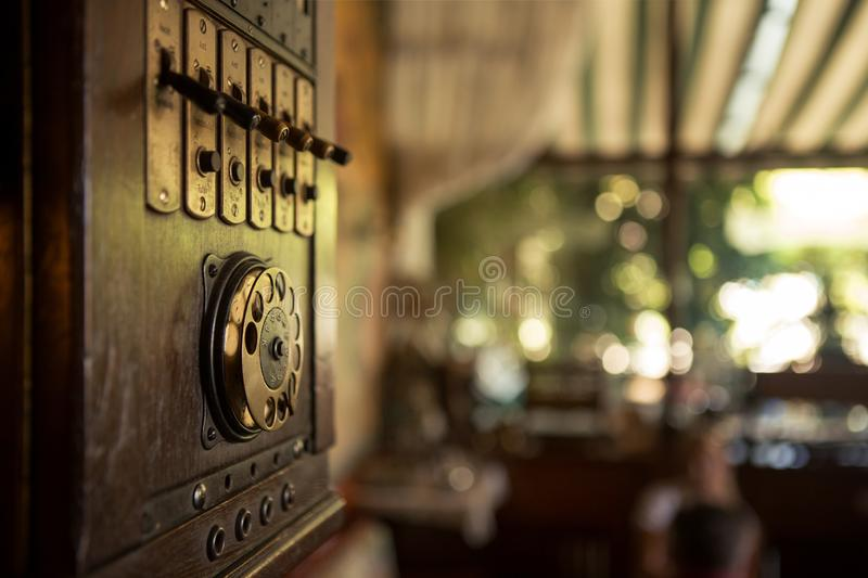 Selective focus on dials and switches on 19th Century Old Style Wall Wooden Phone. The phone is much used but is still in good royalty free stock photos