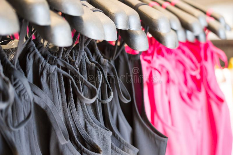 Selective focus, Fashionable clothes in a boutique store, Fashion cloth of women on rack in summer sale.  royalty free stock photos