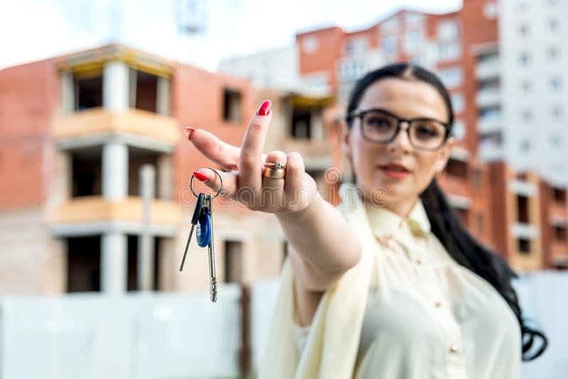 Selective focus on female hand with keys from new apartment stock image