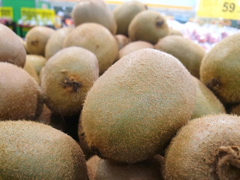 Selective focus of fresh kiwi on shelf for sale in the supermarket royalty free stock photo