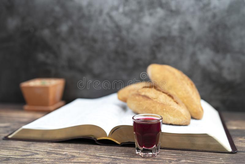 Selective focus at  grape juice  with bread and bible for inspiration and background royalty free stock photos