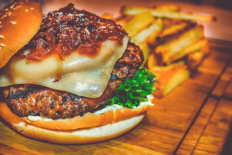 Selective Focus of Ham Burger on Wooden Surface Photo stock photos