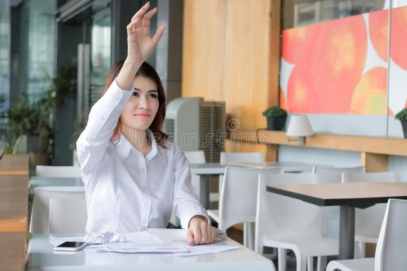 Selective focus on hands of frustrated Asian businesswoman throwing crumple paperwork in workplace. Stressed business concept royalty free stock photography