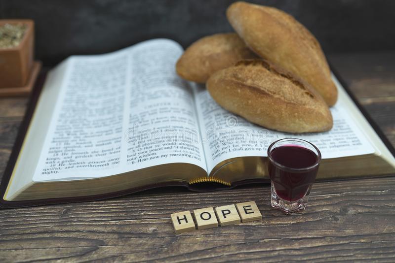 Selective focus at  hope spelling  with bread and bible for inspiration and background royalty free stock photos