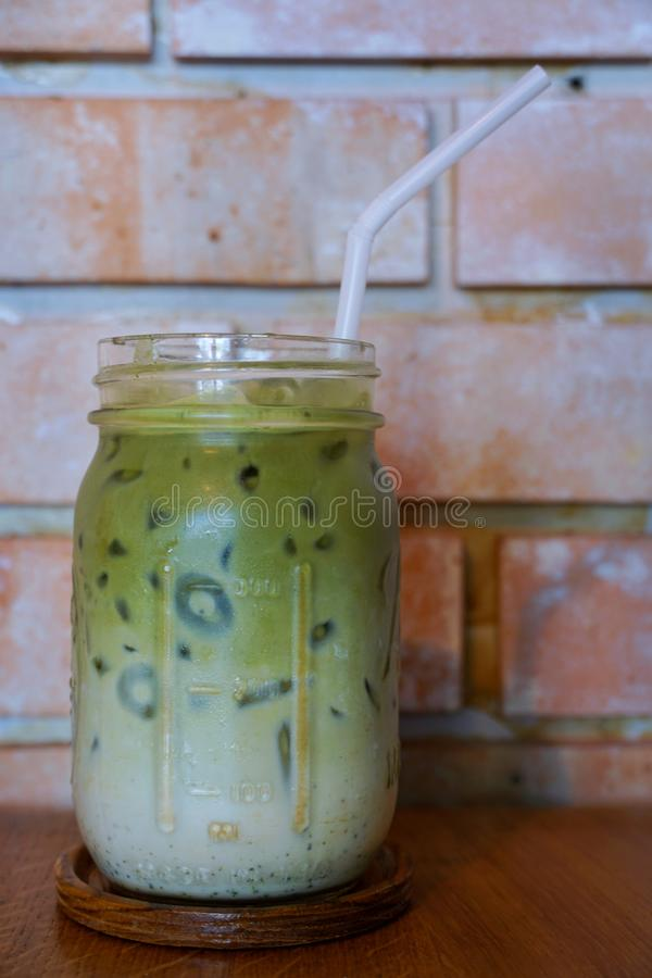 Selective focus of iced green tea in glass on wooden table stock photos