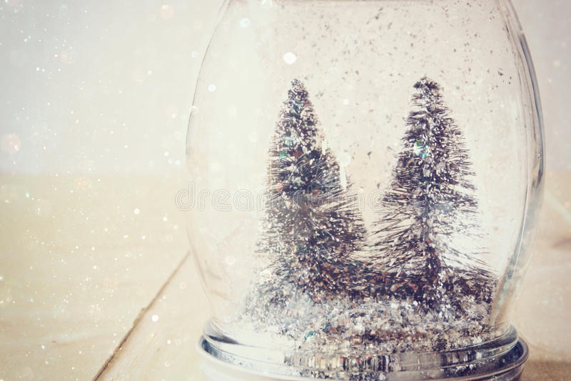 Selective focus image of christmas trees in mason jar. glitter overlay royalty free stock photo