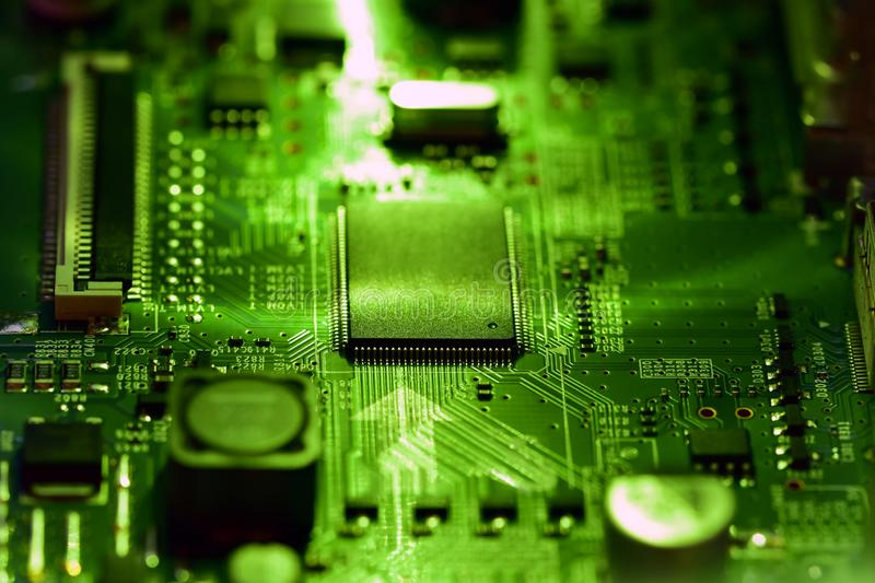 Integrated electronic circuit and microprocessor in a bright green light. Selective focus, integrated electronic circuit and microprocessor in a bright green stock photos