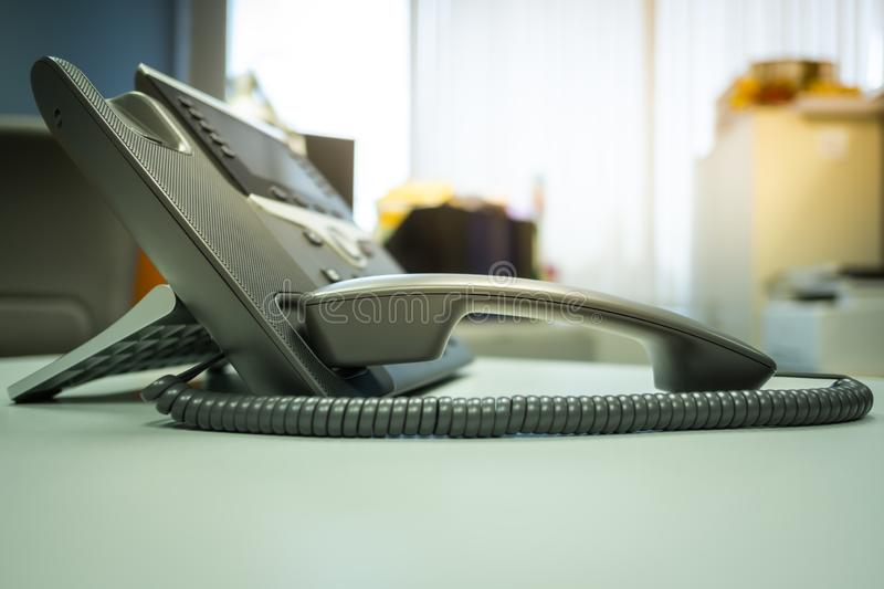 Selective focus ip phone deveice on office desk. Closeup ip phone deveices put on office desk in the room , Concept sunsets royalty free stock photography