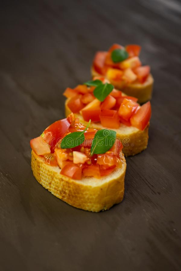 selective focus, Italian snack bruschetta, with tomatoes and basil royalty free stock photos