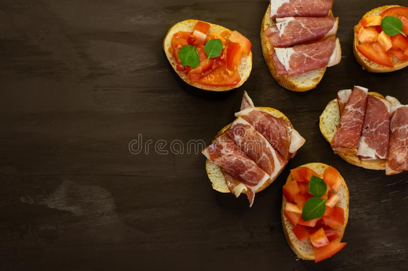 selective focus, Italian snack bruschetta, with tomatoes and smoked meats royalty free stock images