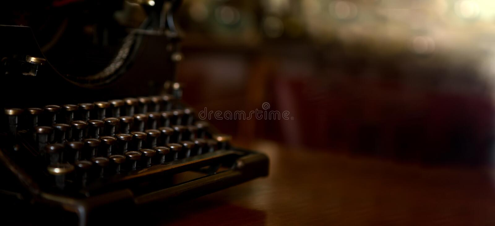 Selective focus on the keyboard key on an old black rustic typewriter on a desk in the office. The typewriter is a lot old so the stock photos
