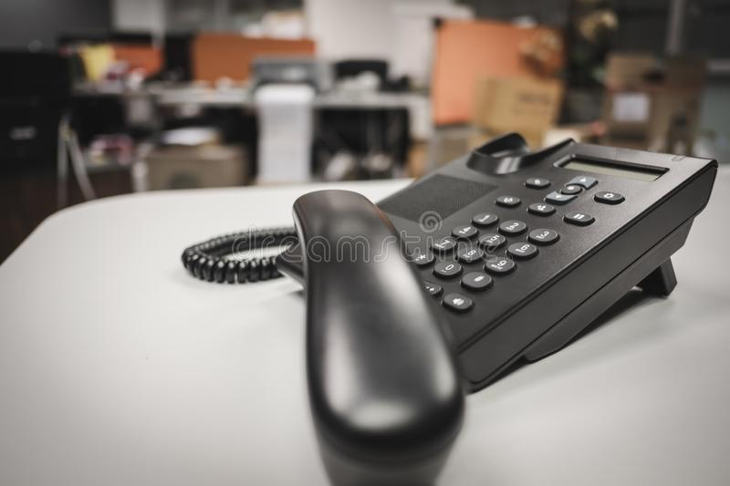 selective focus keypad ip phone deveice on office desk stock image