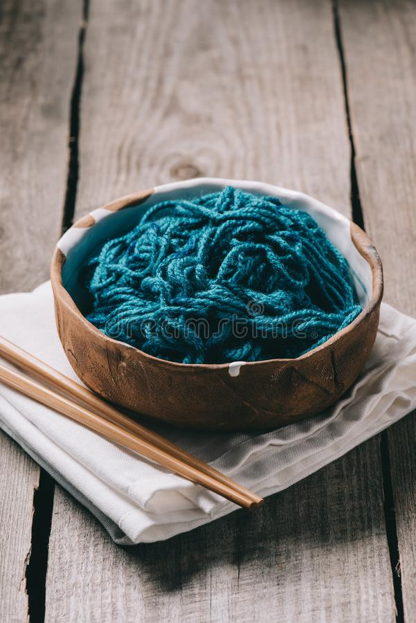 selective focus of knitting needles bowl with untangled knitting yarn and sackcloth stock photo