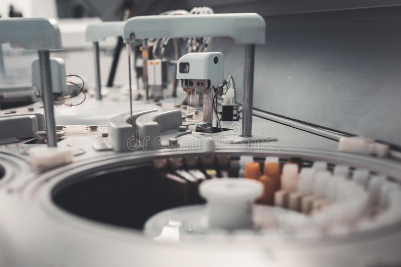 Selective focus of laboratory equipment for analyses. Power of progress. Selective focus of laboratory equipment being set in well supplied hospital stock image