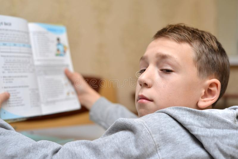 Selective focus of little boy learning how to write his name, Kid study at home, Children do homework at home, Concept for toddler. Learn about writing the royalty free stock photo