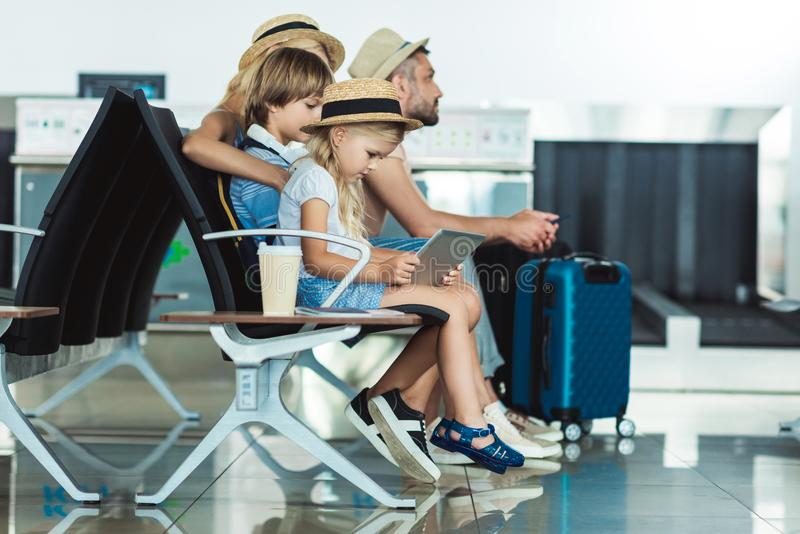 Kid with tablet at airport royalty free stock photography