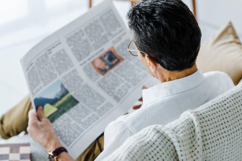 Selective focus of man reading newspaper royalty free stock photos