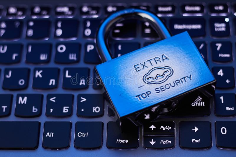 Selective focus on metal lock on keyboard password internet online data privacy information protection security concept in dark. Tone low key royalty free stock images