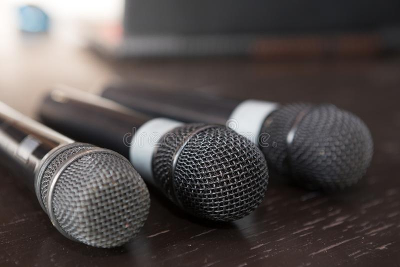 Selective focus of microphone on wooden table stock photography