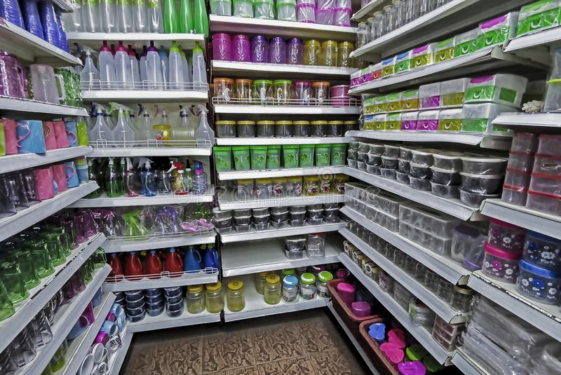 Objects. Selective focus. Motion blur. Noise. Grain. A row of different kinds of plastic goods in the supermarket royalty free stock photo