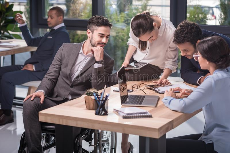 selective focus of multiethnic business team working together royalty free stock photo