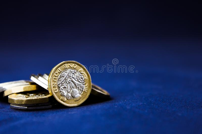 Selective Focus of the New UK One Pound Sterling Coin - money concept, economy concept, credit crunch stock image